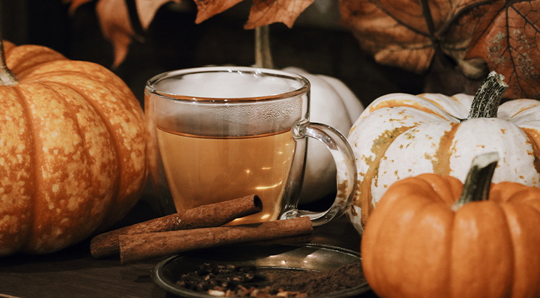 Chado Tea's Mulling Spice Tea Surrounded by Pumpkins