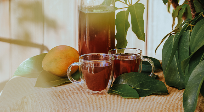 Two Tea With Mango Near Wooden Fence