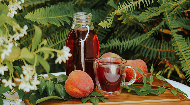 Red Tea With Peaches And Flowers
