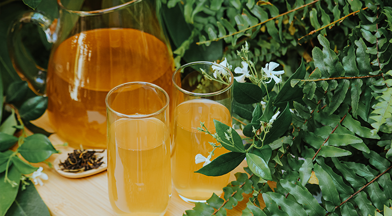Two Yellow Color Tea Surrounded By Leaves