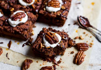 Protein-Packed Chocolate Date Brownie With Candied Maple Pecans.