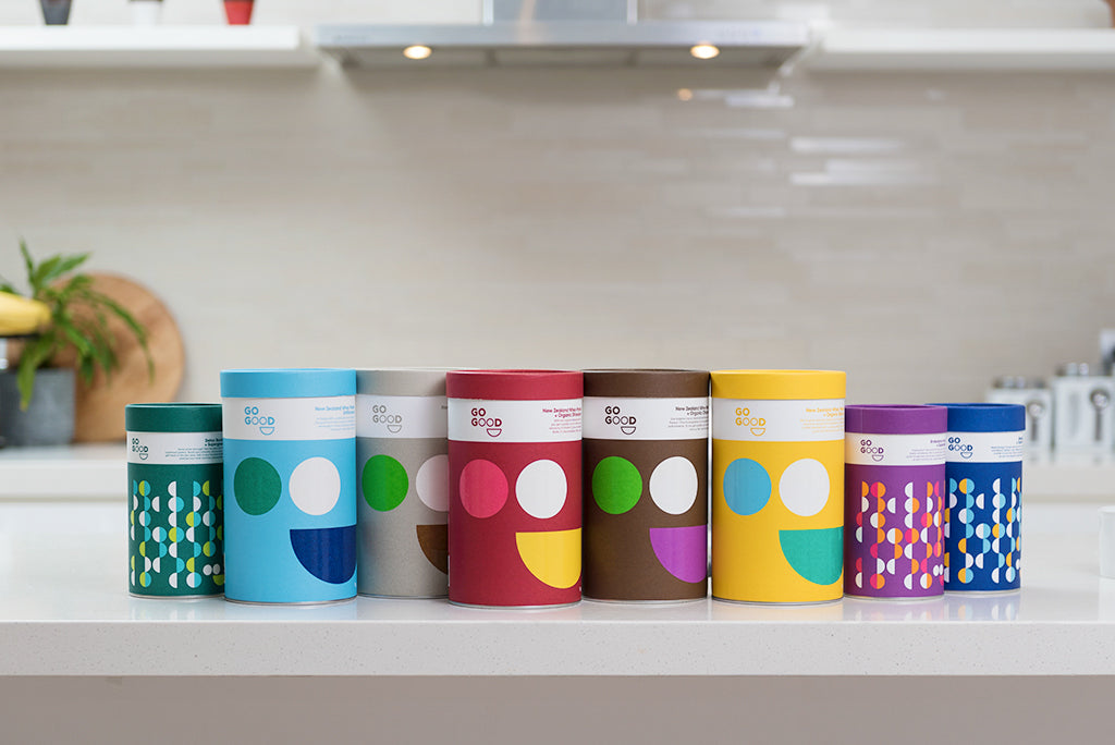 Colorful Go Good canisters on a kitchen bench.