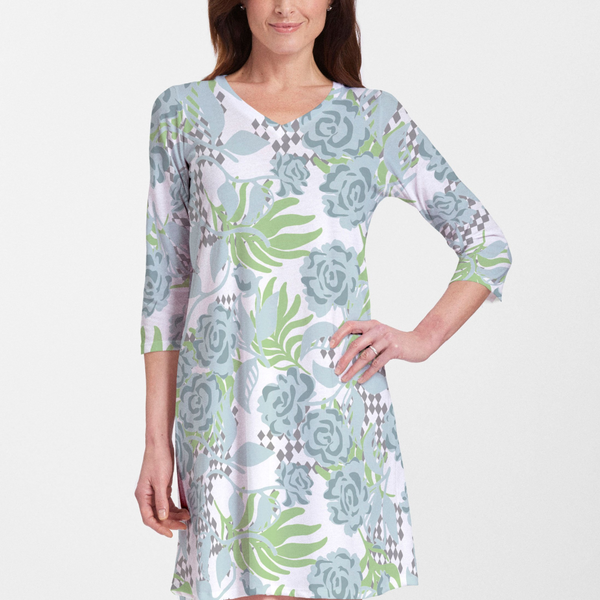Playful floral print dress in light blue and lime green with black and white checkered accents - Pike Creek Boutique