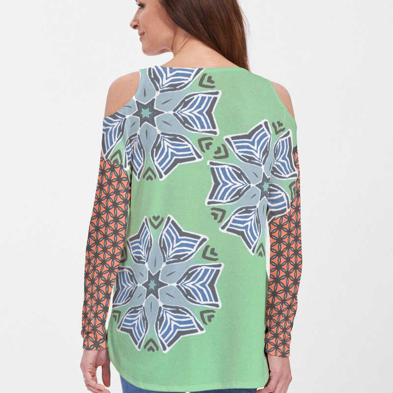 Eclectic mix of turquoise blue, green and orange geometric print blouse with contrasting sleeve designed by JoAnn Lieberman - Pike Creek Boutique