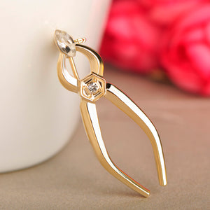 Gold Color dental forcep pattern Brooch - Dental Desire.com