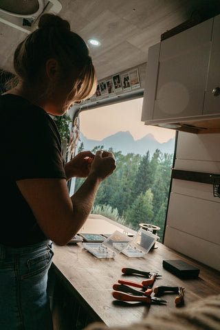 making jewelry in a campervan