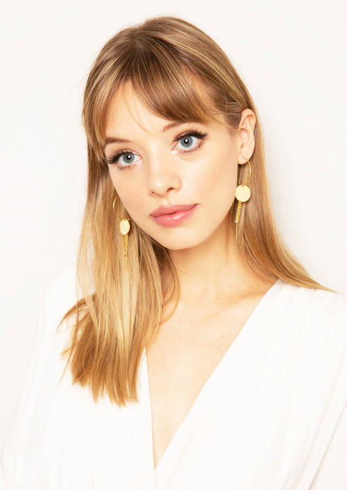 14K gold plated hoop earring featuring chain fringe on round plate