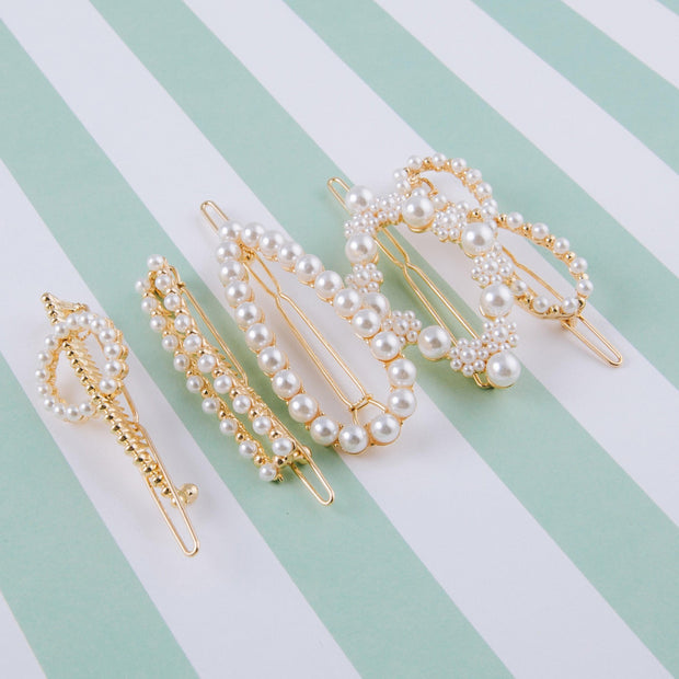 Bow 0r Pointed Oval Hair Clip Featuring Pearl Beaded Details.