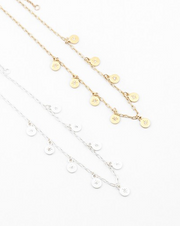 Delicate disc with starburst charm necklace