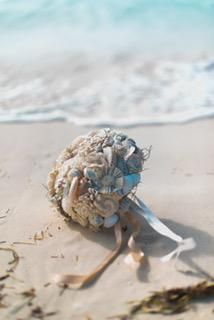 Seashell and sola flower bridal bouquet on the beaches of the Bahamas.