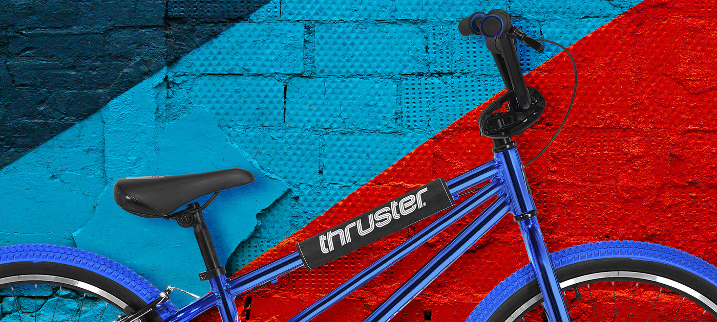 "A blue and red wall with a closeup potrait of the 24"" redesigned Thruster Tri Power Pro XL"