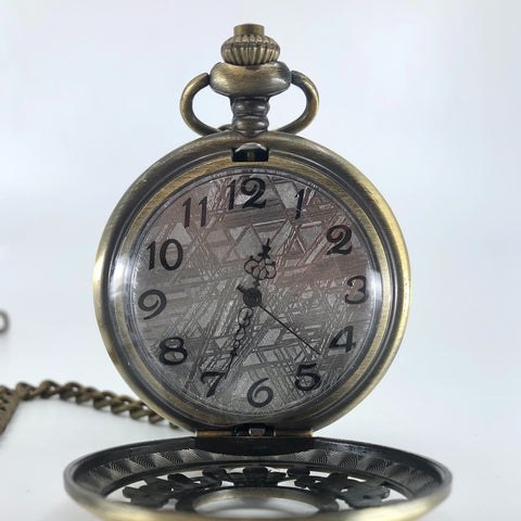 Bronze tone meteorite pocket watch with flower pattern lid