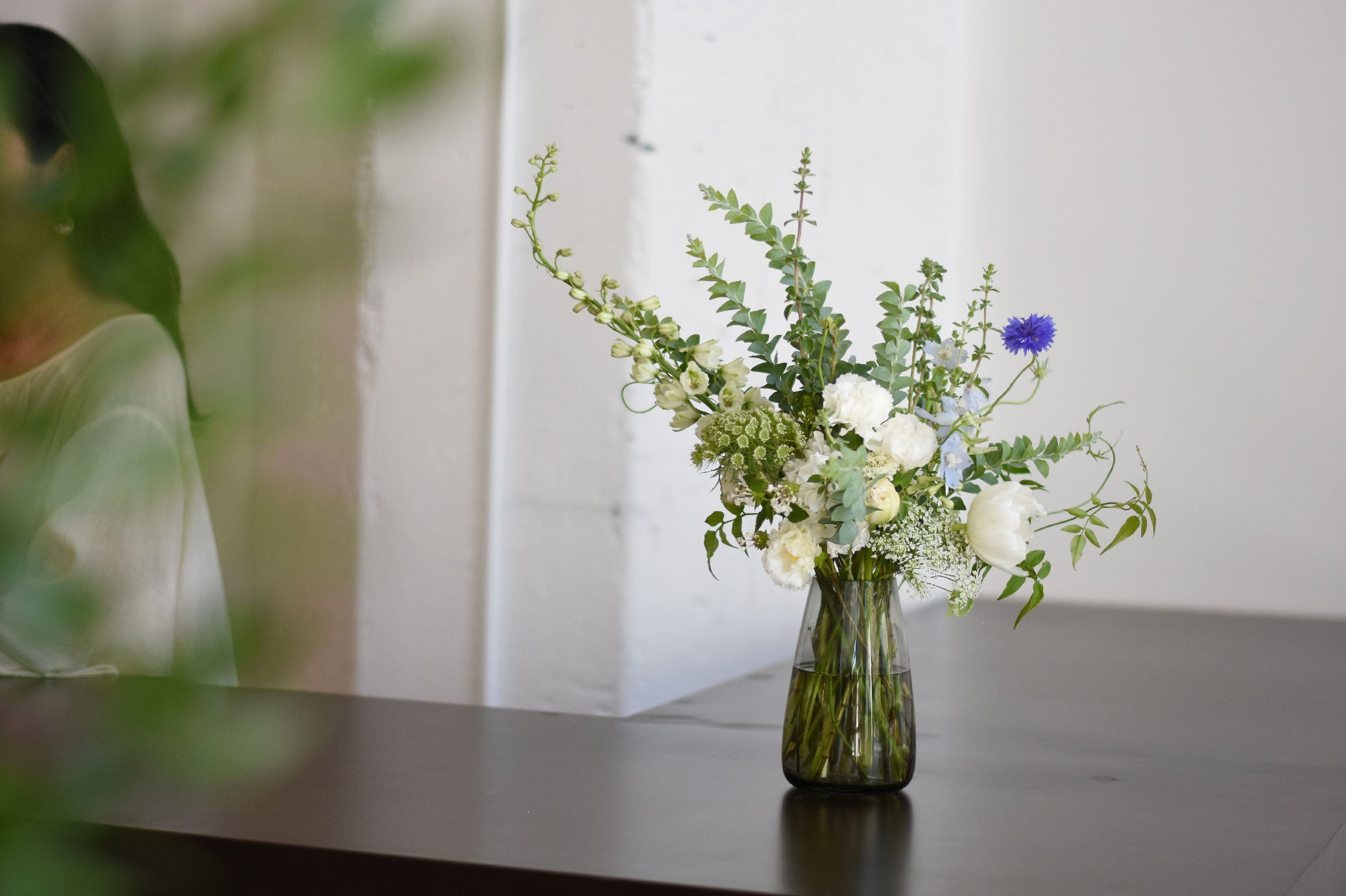 AQUA CULTURE VASE with assortment of flowers on a counter top