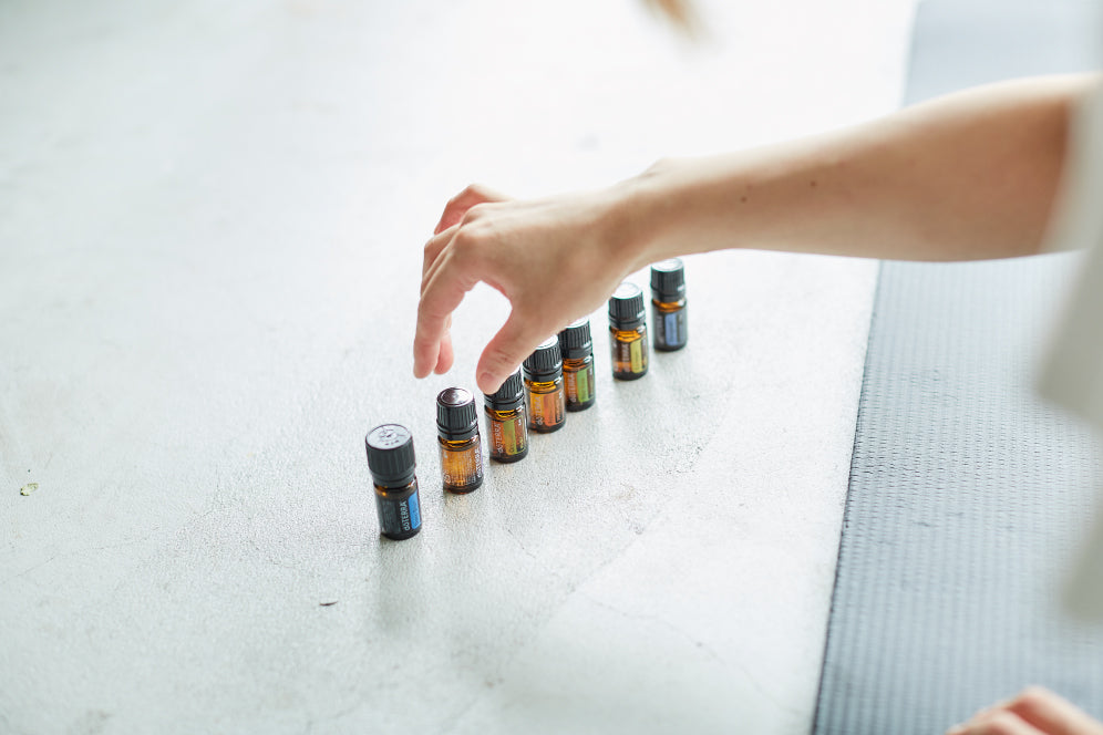 Person selecting from a row of essential oils