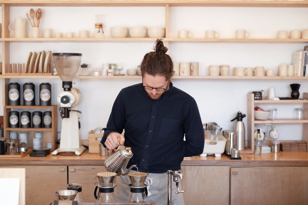 MARU barista making pour over coffee