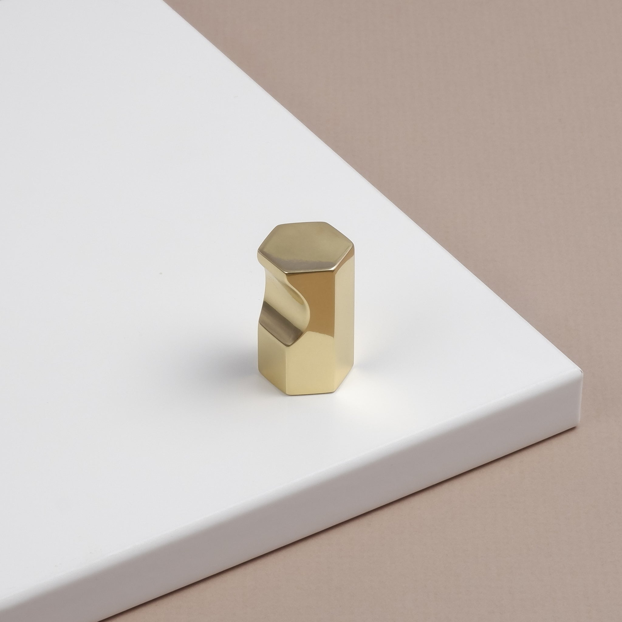 Hexagonal polished brass cupboard handle