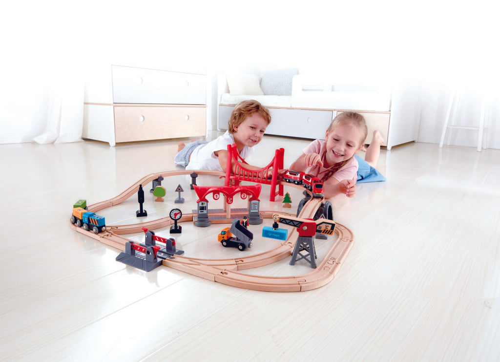 Hape Busy City Rail Set is wooden railway and train set The Toy Wagon