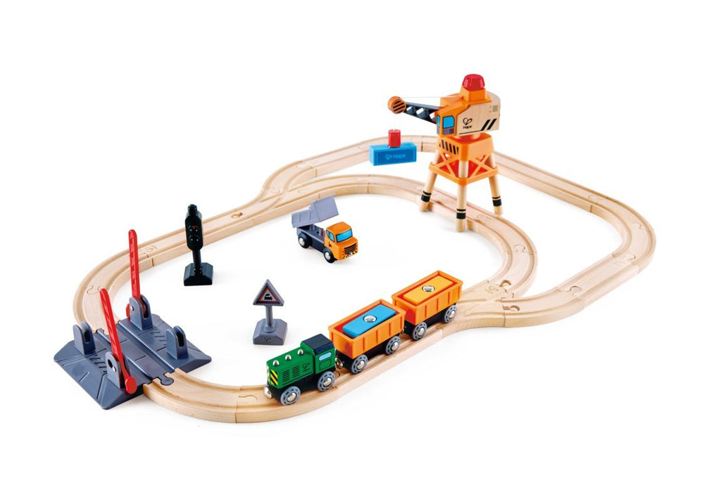 Hape Crossing & Crane Set is wooden railway and train set The Toy Wagon