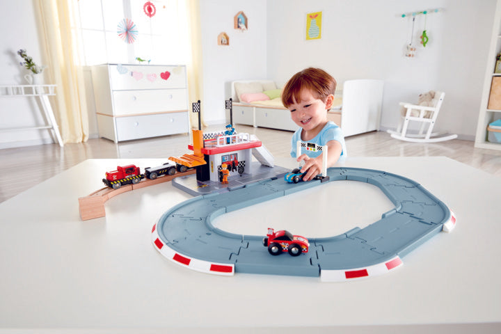 Hape Race Track Station is wooden railway and train set The Toy Wagon