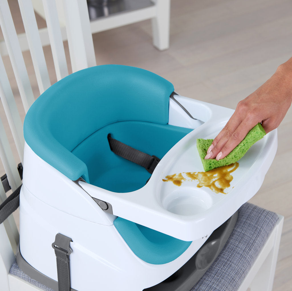 The Ingenuity Baby Base 2-in-1 Booster Seat easily attaches to dining chairs so your baby can sit up higher and see more during family dinners.