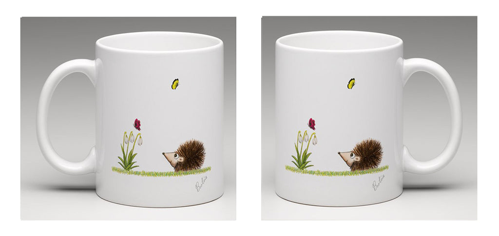 Ceramic mug with a beautifully hand draw illustration of a hedgehog watching butterflies, by Bootsie.