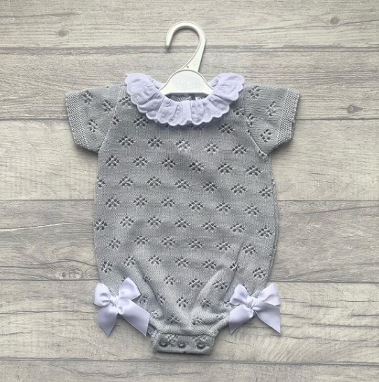 Knitted grey romper with bows and lace collar