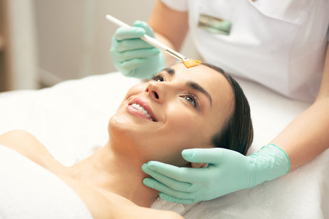 facials, facial Toronto: woman receiving facial treatment