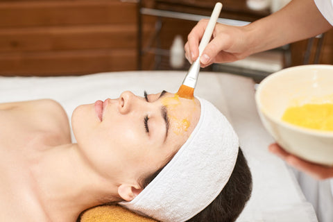 glycolic acid peel, TCA peel: woman receiving facial at facial spa