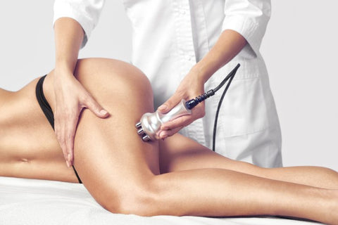 Cavitation treatment: breaking cellulite of woman's tight
