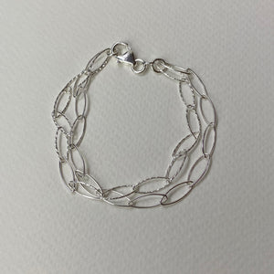 Silver Bracelet of two chains.