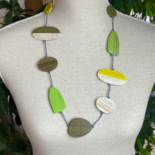 Load image into Gallery viewer, Wooden shapes necklace in Greens Yellow and Natural
