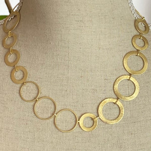 Gold Chain Necklace with Varied Circles.