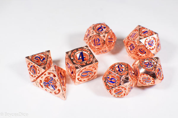 Rose Gold Metal Hollow Gear Dice with Blue Numbers 7-Dice Set