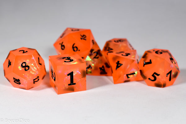 Orangetober Sharp Edge Resin 7-Dice Dice (Orange w/ Black Numbers)