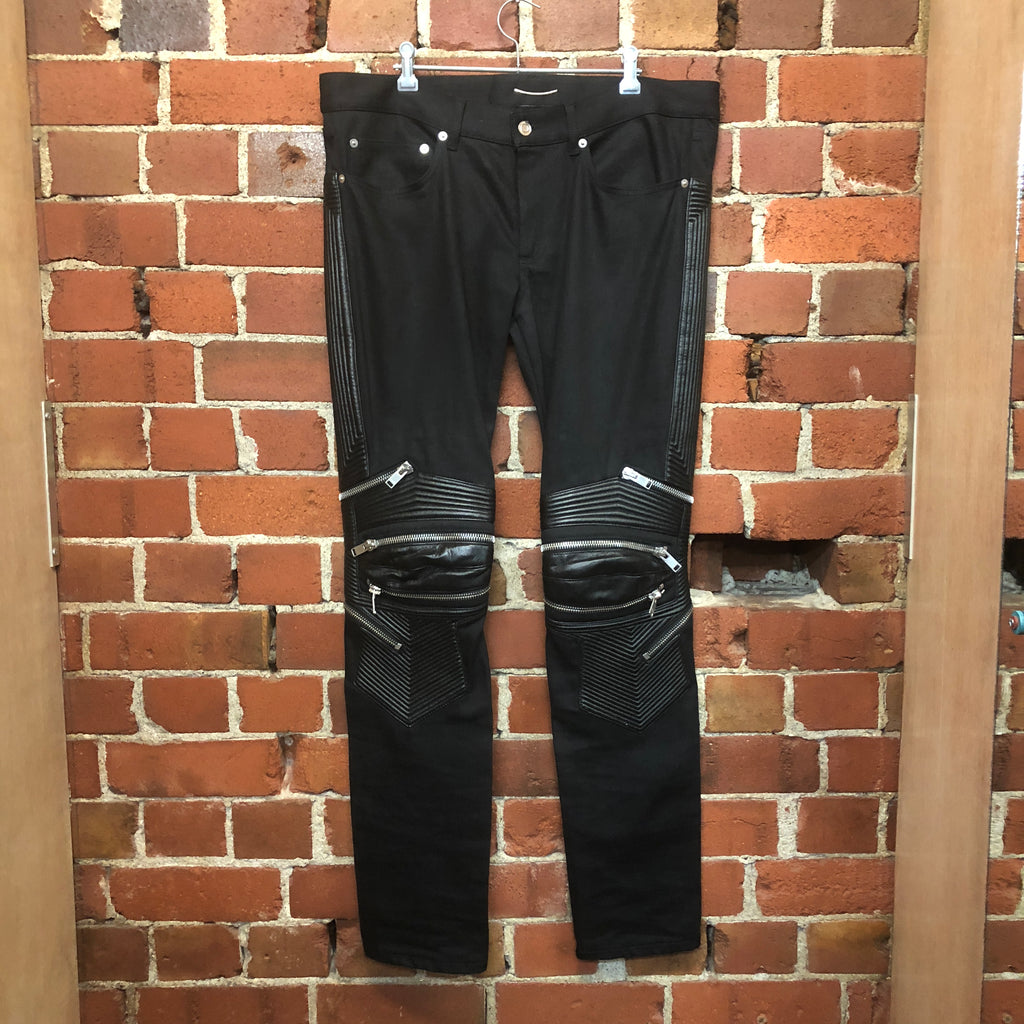 SAINT LAURENT leather knee biker jeans