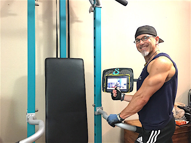 Joey Following a SCULPTAFIT Home-Gym 1-on-1 Personal Training Session Video On a Tablet