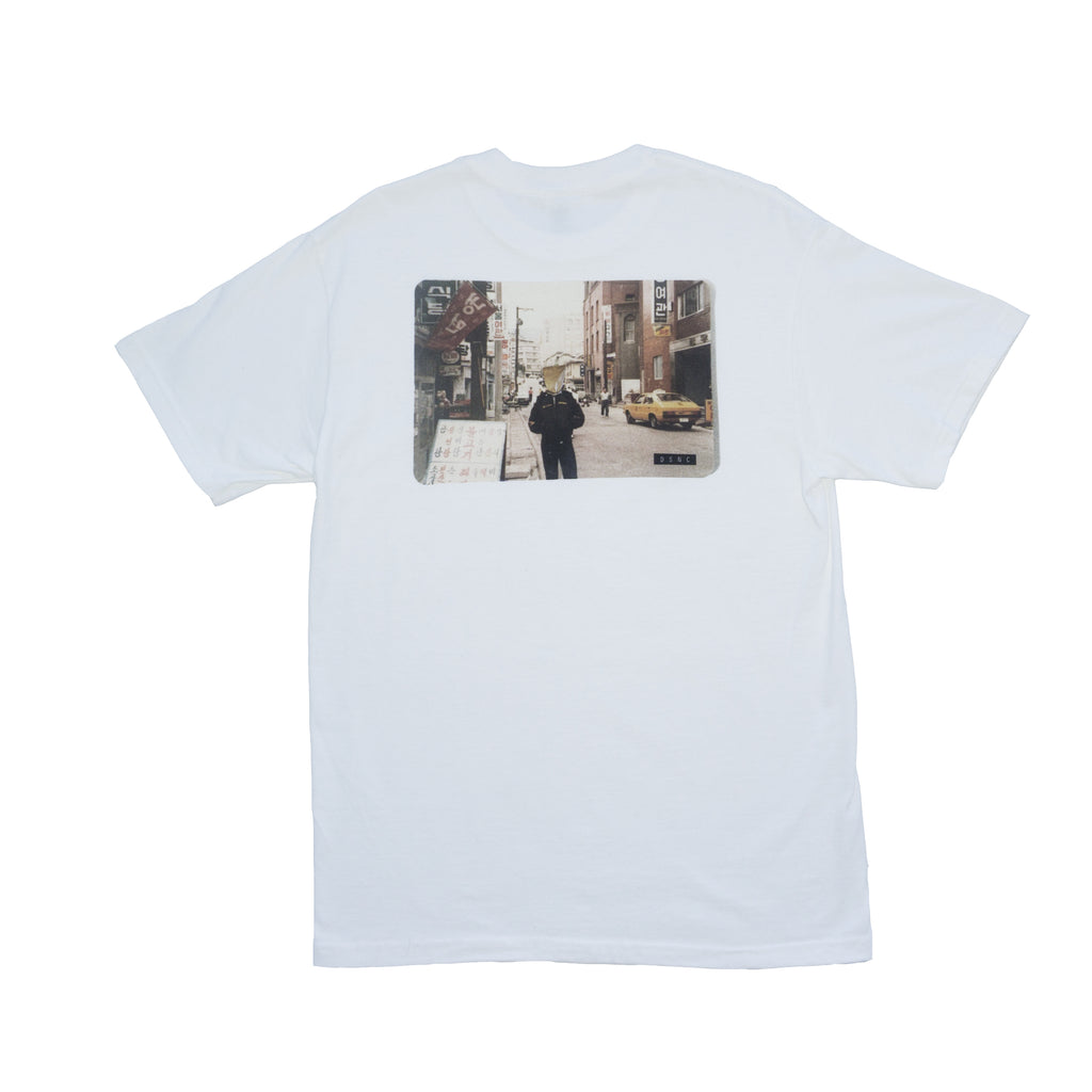 DSNC where you at tee, white,  back side, classic fit t-shirt, graphic tee, photo graphic design imagery, paper bag on a mans head in the street, dsnc class one T-shirt.