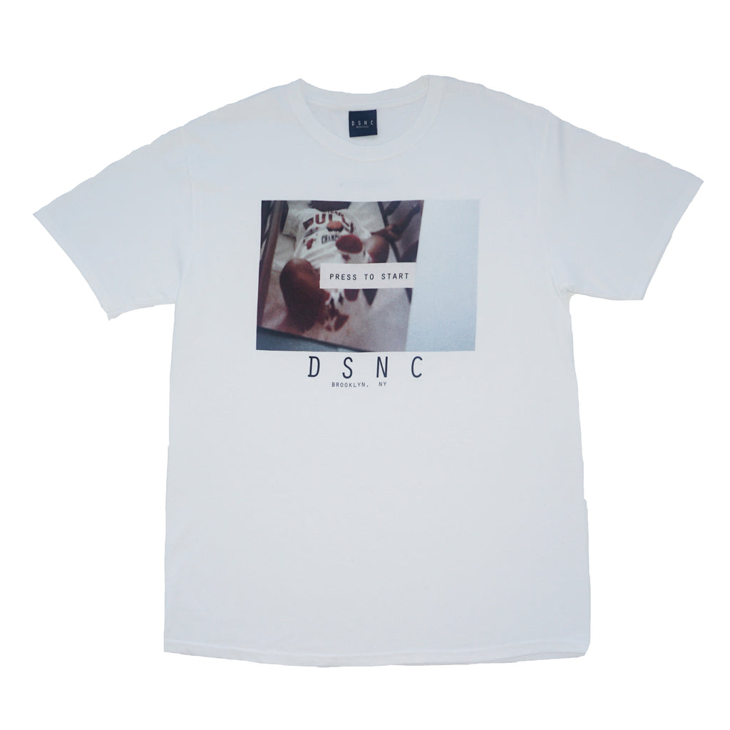DSNC origins tee, white, front side of the tee, classic fit t-shirt, graphic tee, says press to start on a photo graphic print, dsnc class one T-shirt.