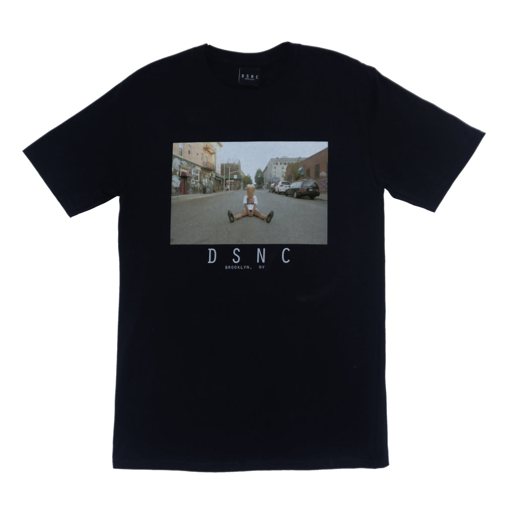 DSNC street minded tee, black, front side, classic fit t-shirt, graphic tee, printed photo of a person sitting in the street, paper bag on the head, dsnc brooklyn, dsnc class one T-shirt.