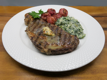 Keto friendly ribeye with radishes and creamed spinach