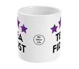 White ceramic mug with Tea First slogan and three pink and blue leopard print stars  and My Other Life logo