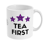 White ceramic mug with Tea First slogan and three pink and blue leopard print stars