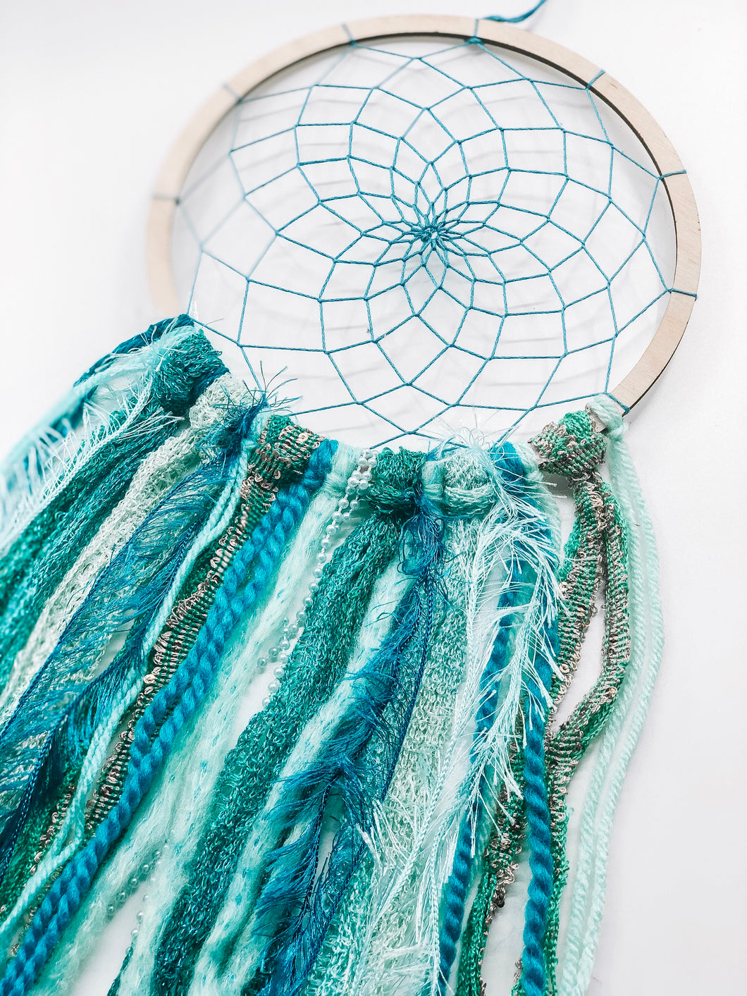 Green Dreamcatcher on wooden hoop