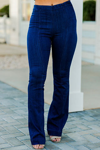 a woman wearing a pair of all smiles dark wash flare jeans