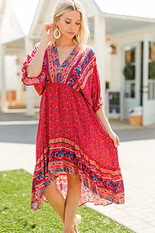 a woman wearing a boho summer red floral mini dress