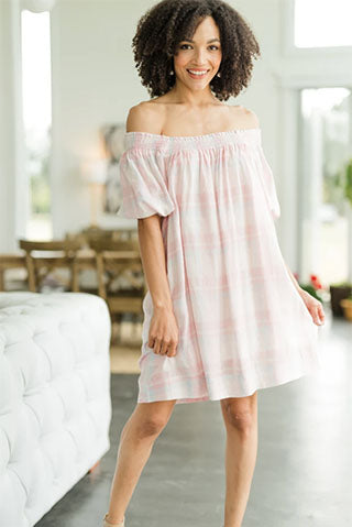 a woman wearing a feeling so special pink plaid babydoll dress