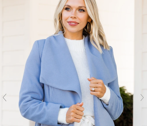 woman wearing powder blue coat