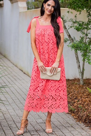 a woman posing in an its the dream coral pink lace midi dress