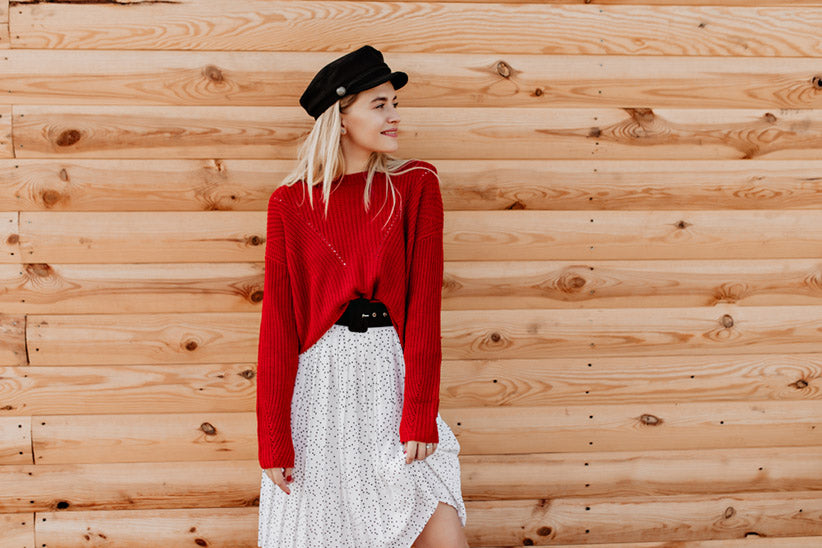 red sweater over dress