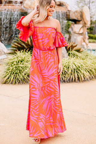 a woman wearing a so much to do red palm print maxi dress